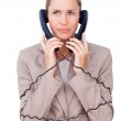 Angry businesswoman tangled up in phone wires — Stock Photo #10287295