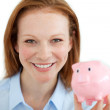 Smiling businesswoman holding a piggybank — Stock Photo #10287624