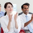 International business clapping at a conference — Stock Photo #10287704
