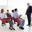 Stock Photo: Senior businessmgiving conference