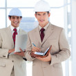 Portrait of two architects wearing hard hat — Stock Photo