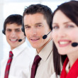 Stock Photo: Customer service agents with headsets on