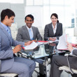 Multi-ethnic business in a meeting — Stock Photo