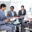 Foto Stock: Multi-ethnic business in meeting