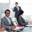Businessman reporting sales figures to his team — Stockfoto