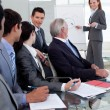 Smiling manager giving a presentation to her team — Stock Photo