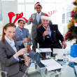 Manager and his team toasting with Champagne at a Christmas part — Stock Photo #10288123