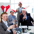 Multi-ethnic busioness team toasting with Champagne at a Christm — Stock Photo