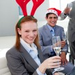 Stock Photo: Portrait of a smiling businesswoman toasting with her colleagues