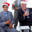 Confident businessmen wearing novelty Christmas hat — Stock Photo #10288128