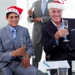 Stock Photo: Confident businessmen wearing novelty Christmas hat