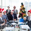 Portrait of a smiling business team wearing novelty Christmas ha — Stock Photo