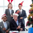 Smiling business wearing novelty Christmas hat — Stock Photo #10288138