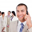 Portrait of caucasian businessman on phone with his team — Stock Photo