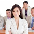 Assertive businesswoman with her team in the background — Stock Photo