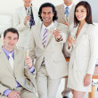 Confident business team celebrating a success — Stock Photo