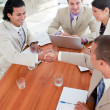 Positive Business associates closing a deal — Stock Photo