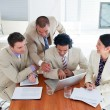 Stock Photo: Ambitious business team having brainstorming