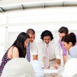 International engineers and their manager discussing blueprints — Stock Photo #10288341