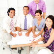 Stock Photo: Multi-ethnic group of architects in a meeting