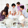 A team of architects at the meeting looking at blueprints — Stock Photo