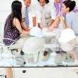 A group of architects studying plans in a meeting — Stock Photo