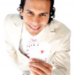 Stock Photo: Charming businessman showing a successful hand of cards