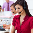 Concentrated Businesswoman using headset — Stock Photo #10288470