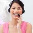 Positive Asian businesswoman talking on headset — Stock Photo #10288486