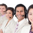 Stock Photo: Young customer service representatives standing in row