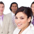 Charming female executive presenting her team — Stock Photo #10288530