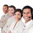 Royalty-Free Stock Photo: Smiling business team lining up with headset on