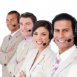 Smiling business team lining up with headset on — Stock Photo #10288541