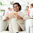 Smiling manager reading a newspaper — Stock Photo #10288613