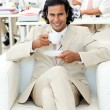 Charming manager drinking a tea - Stockfoto