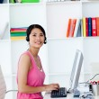 Smiling businesswoman with headset on in the office — Stock Photo #10288638