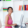 Smiling businesswoman with headset on in the office — Stock Photo