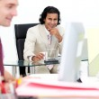Two smiling businessmen working in the office — Stock Photo