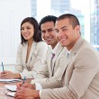 Smiling business associates in a meeting - Stock Photo