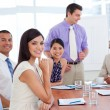 Portrait of a successful business team at a presentation - Stock Photo
