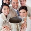 Successful business team showing their throphy — Stock Photo