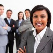 Stock Photo: Ethnic businesswomsmiling at camera