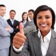 Stock Photo: Attractive female executive smiling at the camera with thumb up
