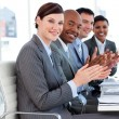 Foto Stock: Multi-ethnic business applauding good presentation