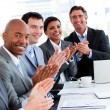 Foto Stock: Team of successful multi-ethnic business applauding