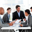 Multi-ethnic business disscussing a budget plan - Foto Stock