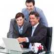 Enthusiastic business team working at a computer — Stock Photo