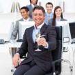 Successful manager and his team drinking champagne — Stock Photo