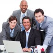 Stock Photo: Ambitious business team working at computer