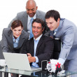 Multi-cultural business team working at a computer — Stock Photo